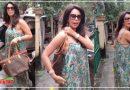 Video: मल्लिका शेरावत ने पहनी बेहद खुली ड्रेस, पर्स की मदद से छिपाती नज़र आई खुद को